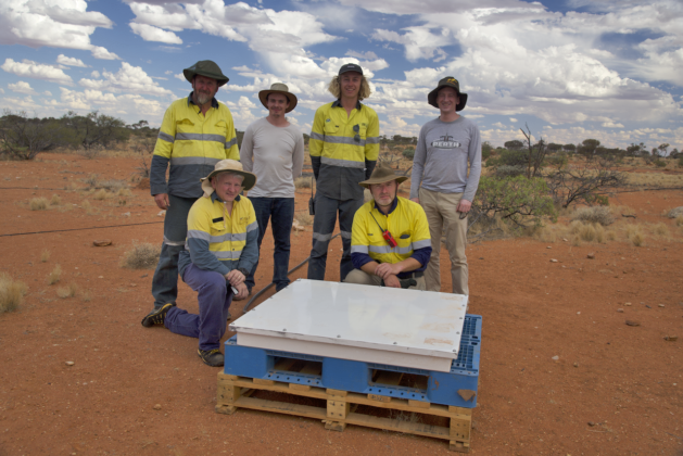 A deployment crew sets up the particle detector at the remote site of the Murchison Widefield Array radio telescope.